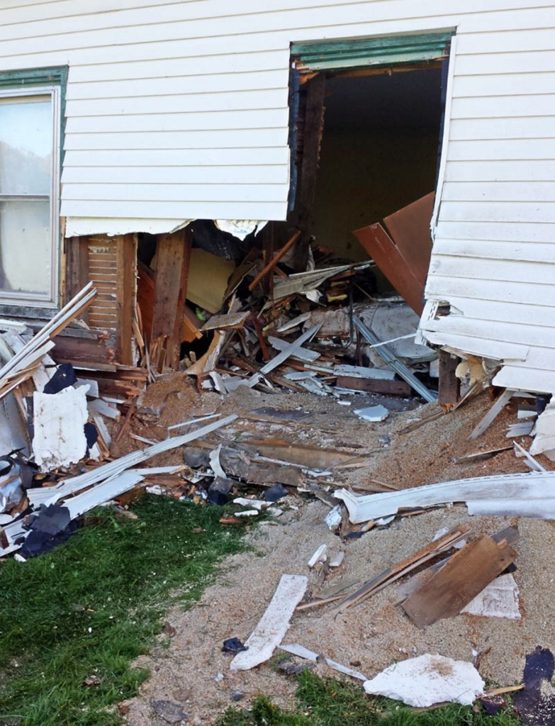A Oldsmobile crashed through this Belgrade home on Knowles Road on Oct. 10, 2013.