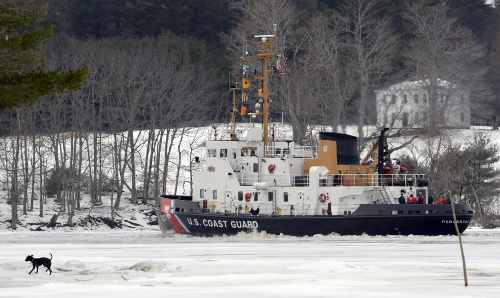 The USCG cutter Penobscot Bay on Sunday breaks a path through the Kennebec River between Richmond and Dresden.