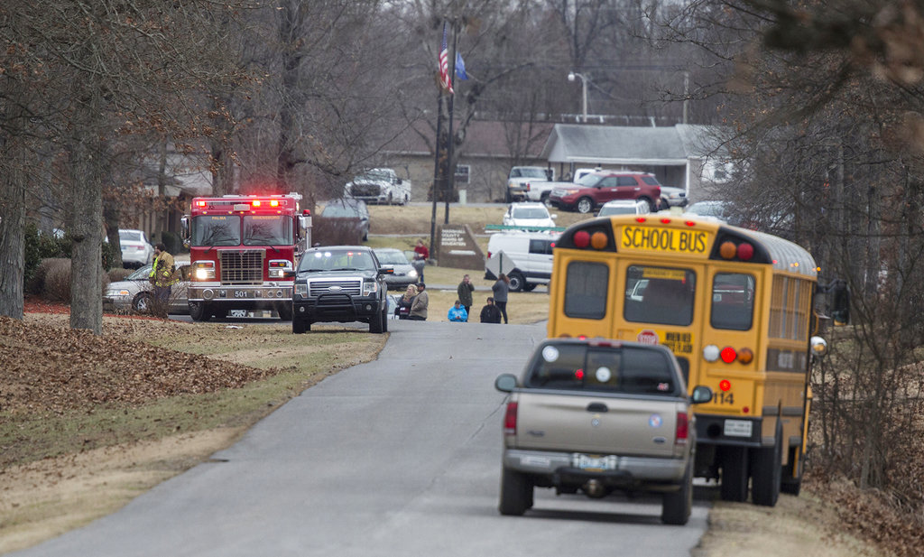 Emergency crews respond to Marshall County High School after a fatal school shooting Tuesday in Benton, Ky.