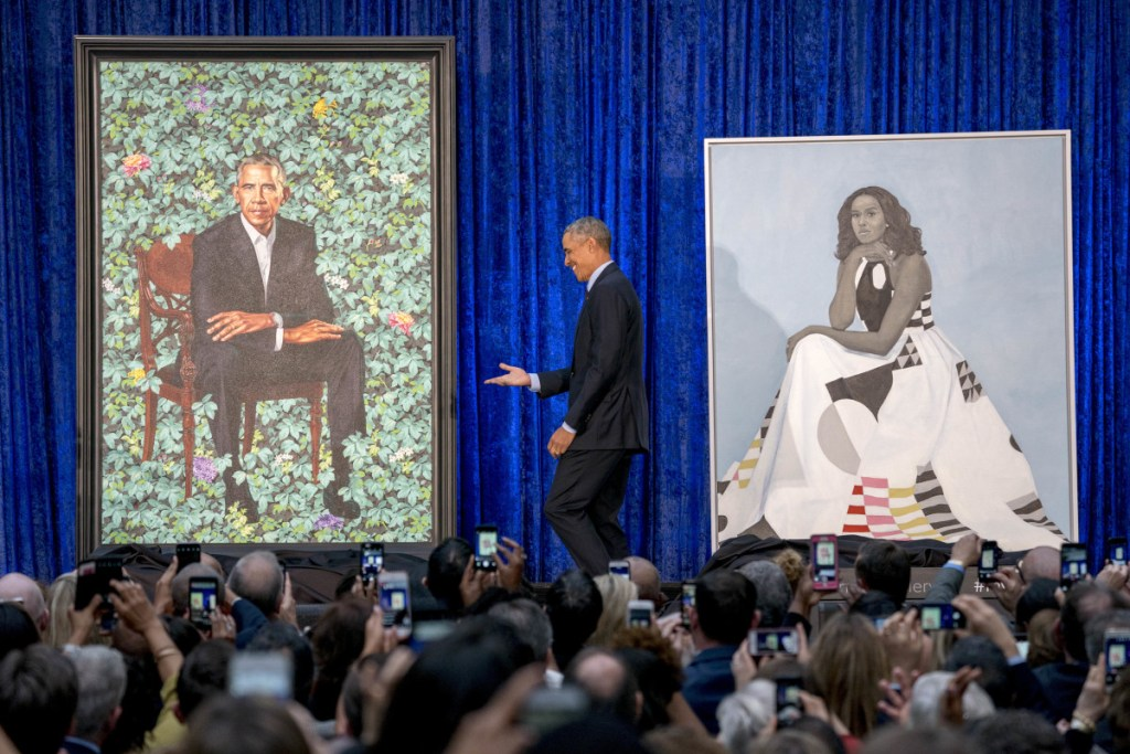 Former President Barack Obama stands on stage during the unveiling of the official Obama portraits at the Smithsonian's National Portrait Gallery on Monday in Washington.