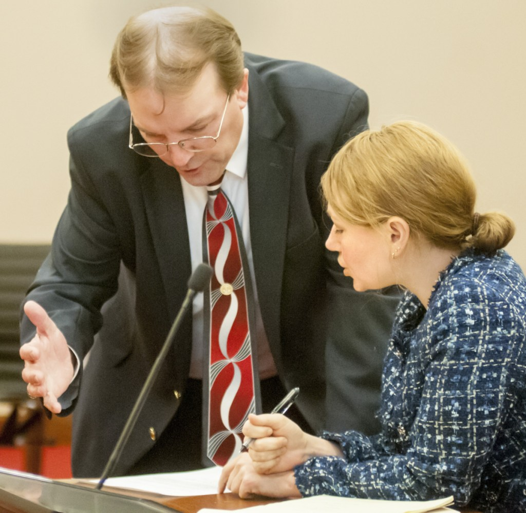 Brent Davis, Gov. Paul LePage's chief legal counsel, and Tracy Collins, the attorney for Washington County commissioners, confer before a brief court hearing Wednesday.
