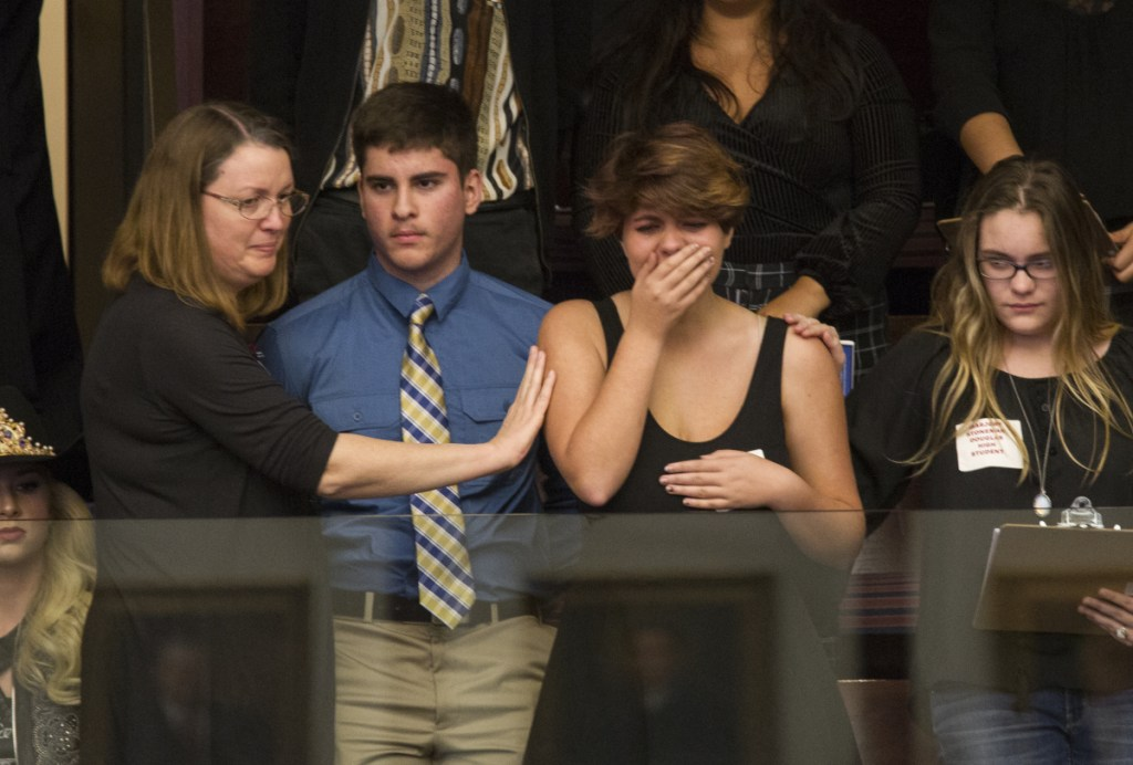 Sheryl Acquarola, 16, a junior from Marjory Stoneman Douglas High School, is overcome with emotion in the gallery of the Florida House of Representatives after the lawmakers Tuesday voted not to hear an assault rifle measure.