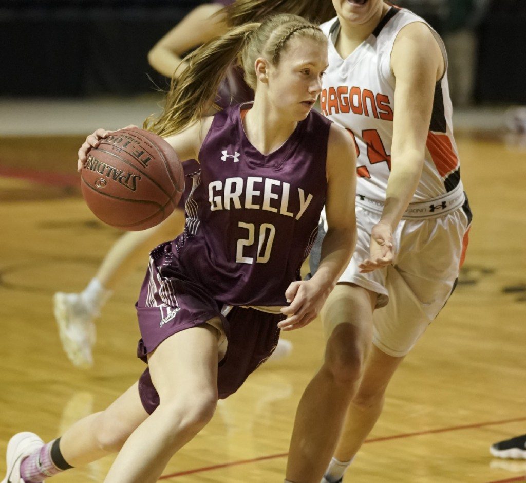 Greely's Anna DeWolfe maneuvers around Brunswick's Alexis Guptil during the Class A South regional final basketball game at the Cross Insurance Arena in Portland on Saturday, February 24, 2018.