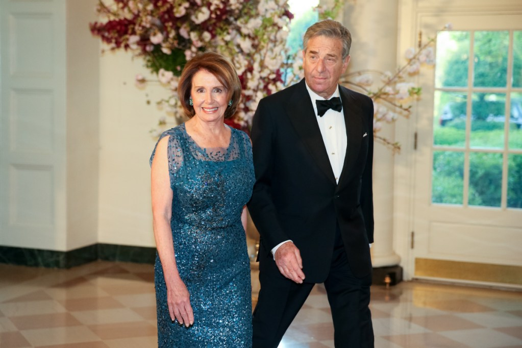 Above, House Minority Leader Nancy Pelosi of Calif., and her husband, Paul, arrive for a state dinner at the White House in 2015. Pelosi, along with Sen. Majority Leader Mitch McConnell, at left, of Kentucky are thought to be two of the 50 richest members of Congress.