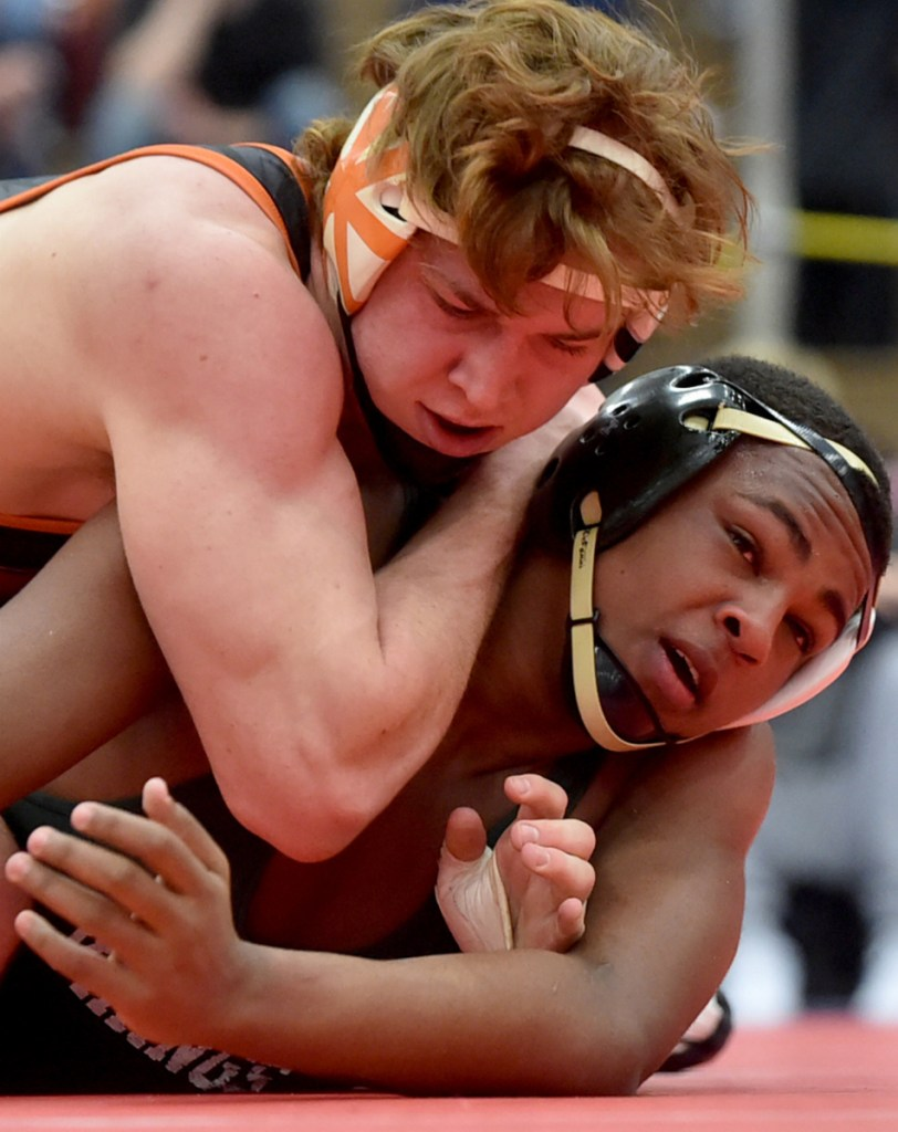 Winslow's Ryan Fredette, left, battles Oxford Hills' Zuka Mabior in the 182-pound championship bout at last season's Kennebec Valley Athletic Conference championships at Mt. Ararat High School in Topsham.