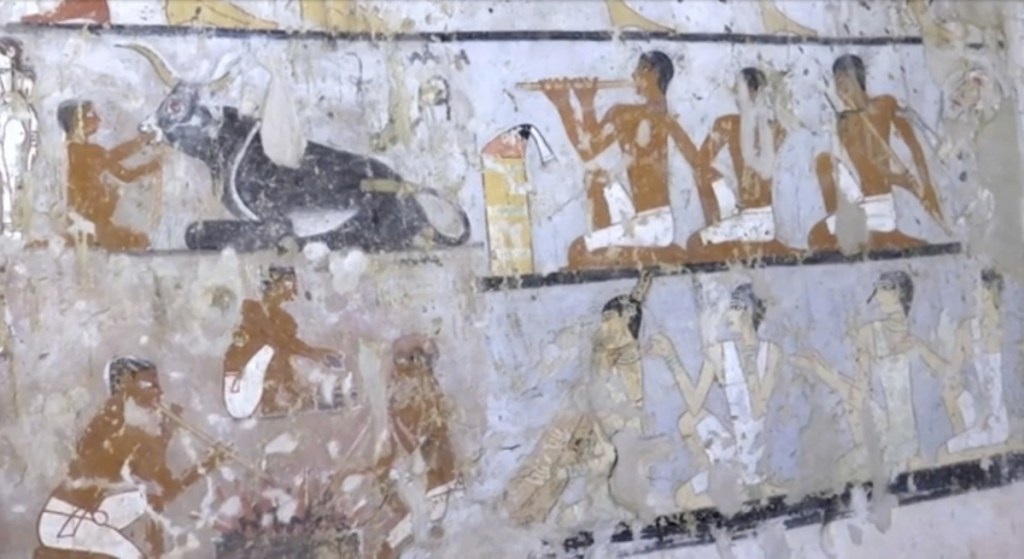 This image taken from video on Saturday, Feb. 3, shows wall paintings inside a 4,400-year-old tomb near the pyramids outside Cairo, Egypt. Egypt's Antiquities Ministry announced the discovery Saturday and said the tomb likely belonged to a high-ranking official known as Hetpet during the 5th Dynasty of ancient Egypt. The tomb includes wall paintings depicting Hetpet observing different hunting and fishing scenes.