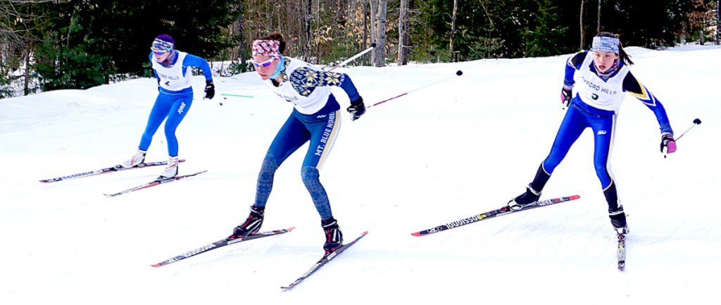 Meg Charles of Mt. Blue High School, center, leads a pair of skiers across the line during the Oxford Hills Sprints at Roberts Farm. At left is Jenny Wilkerson of Morse, and at right is Eva Clement of Falmouth.