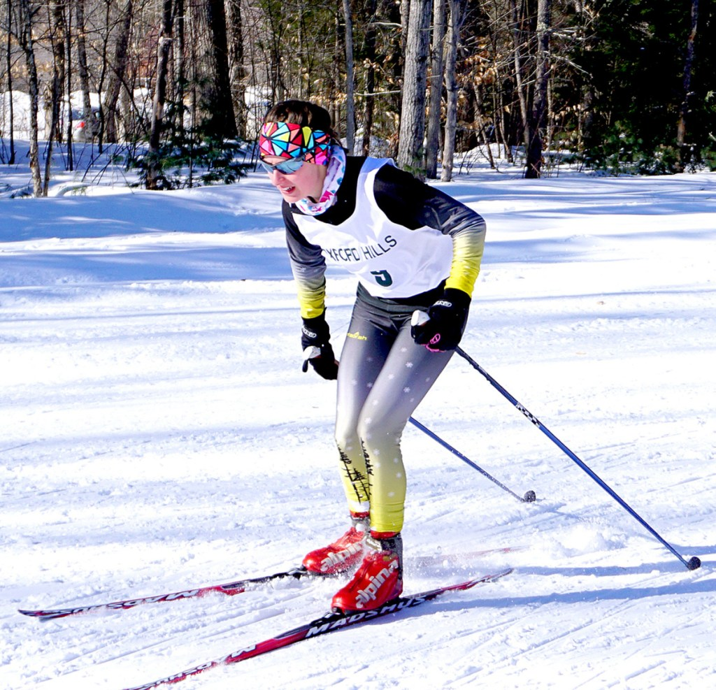 Maranacook High School's Lauren Parent takes the final turn of the race during the Oxford Sprints at Roberts Farm on Saturday.