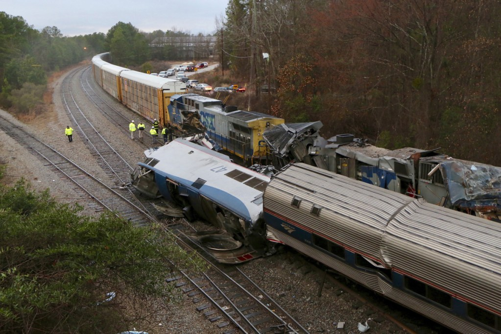 Authorities investigate the scene of a fatal Amtrak train crash Sunday in Cayce, South Carolina. At least two were killed and dozens injured.
