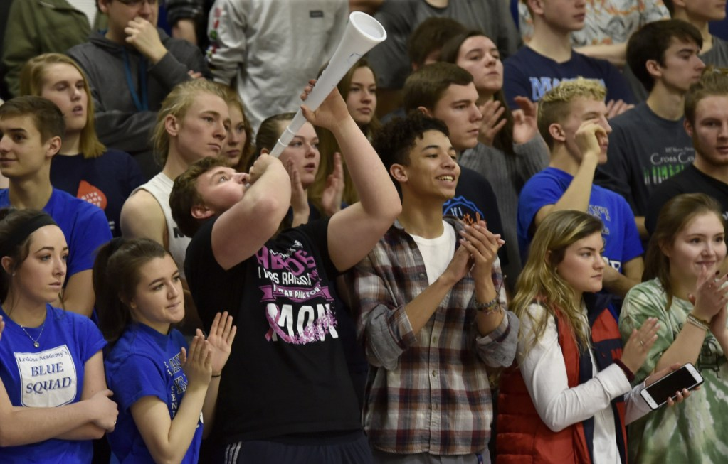 Erskine Academy students, including Derrick Dyer with horn, cheer in support of the girls basketball team, which was recognized for raising $10,000 for the American Cancer Society during a ceremony Tuesday at the South China school.