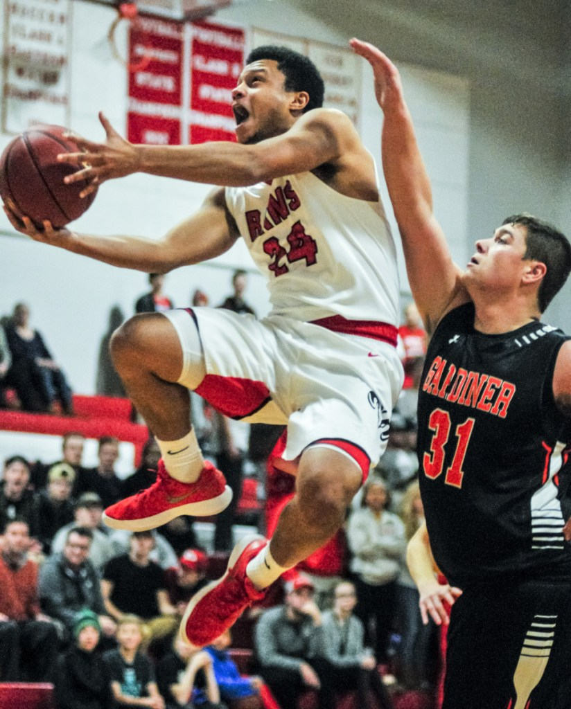 Cony's Jordan Roddy, left, goes up for a shot as Gardiner's Ben Shaw defends during a game earlier this season at Cony High School in Augusta.