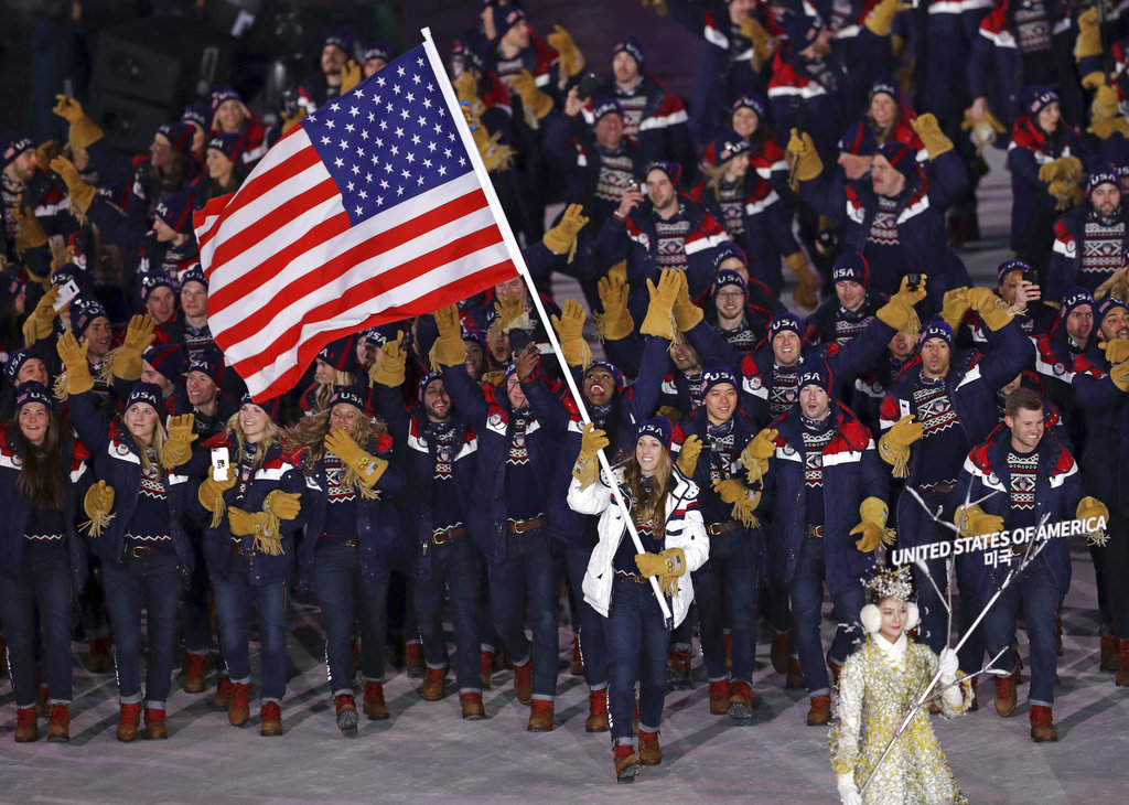 Erin Hamlin carries the flag of the United States during the opening ceremony of the 2018 Winter Olympics in Pyeongchang, South Korea, Friday.