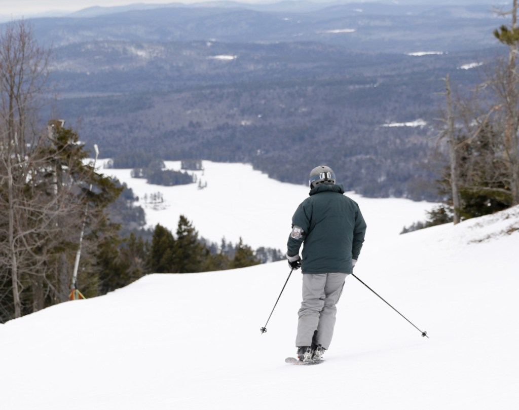 A skier takes a run at Shawnee Peak in Bridgton in January 2017. The ski area on the side of Pleasant Mountain is celebrating its 80th anniversary this season.