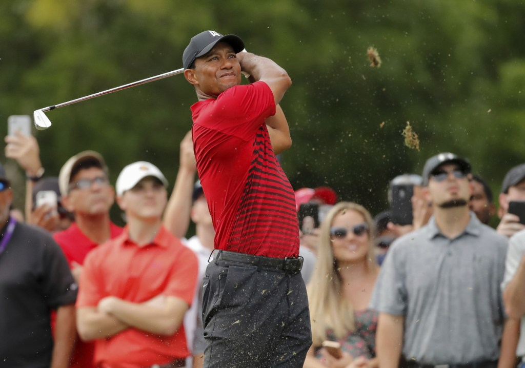 Tiger Woods tees off on the 15th hole during the final round of the Valspar Championship Sunday in Palm Harbor, Fla. Woods finished one shot behind winner Paul Casey.
