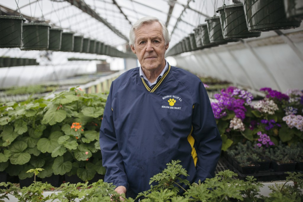 Neil Lash inside the Heirloom Seed Project greenhouse at Medomak Valley High.