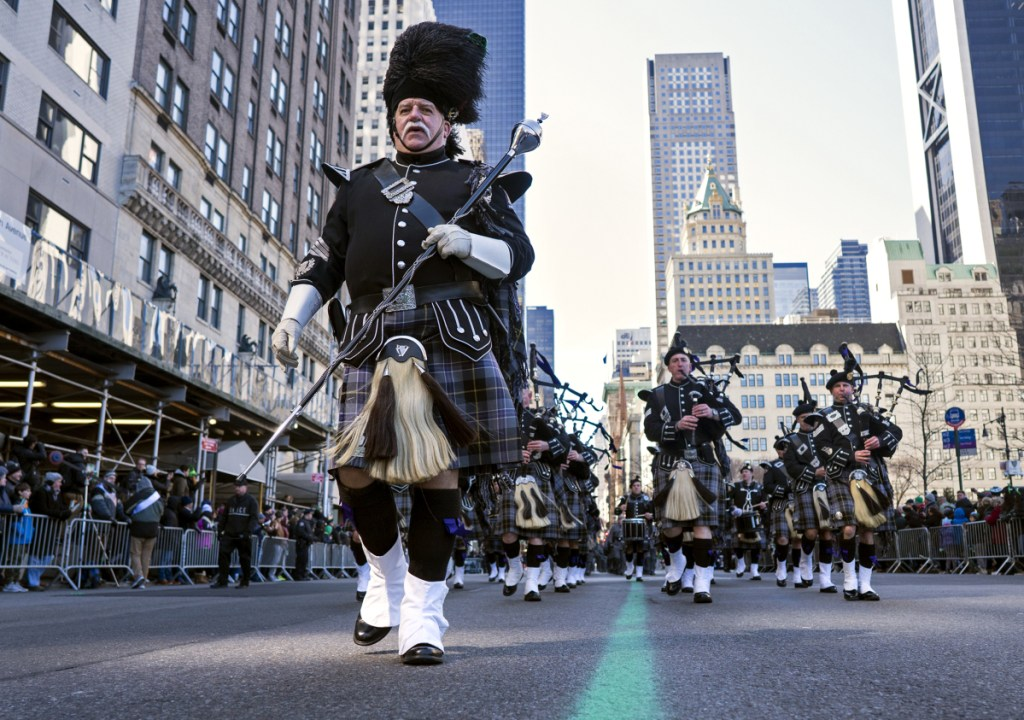 """A bagpipe unit representing the New York State Police takes part in the St. Patrick's Day parade on Fifth Avenue in New York on Saturday. Several bagpipe bands led a parade made up of over 100 marching bands after Democratic Gov. Andrew Cuomo spoke briefly, calling it a """"day of inclusion"""" and adding: """"We're all immigrants."""" Associated Press"""