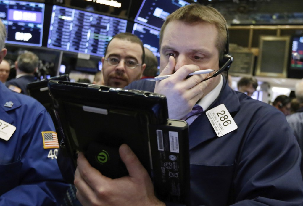 Trader Michael Milano, right, works on the floor of the New York Stock Exchange on Monday. And the news of the day here And the news of the day here And the news of the day here And the news of the day here