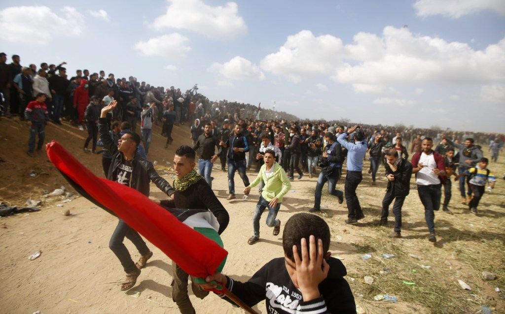 Palestinian protesters  along the Gaza Strip border with Israel, east of Khan Younis, Gaza Strip, on Friday.