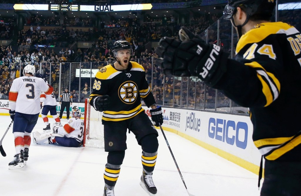 Boston's Jake DeBrusk, right, celebrates his goal with Kevan Miller during the second period of Saturday's game against the Florida Panthers in Boston. The Bruins won, 5-1.