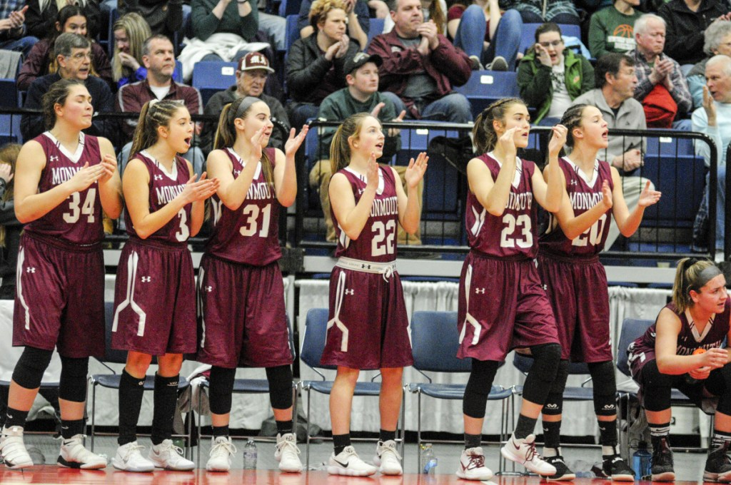 Members of the Monmouth Academy girls basketball team react during the Class C South title game last week at the Augusta Civic Center.