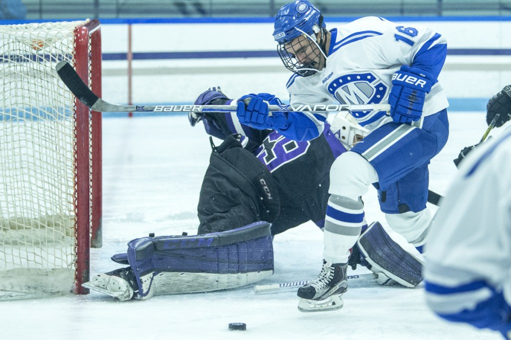 Colby College's John Rourke tries to score on Amherst College goalie Connor Girard earlier this season at Colby College in Waterville. Colby beat Amherst in the NESCAC quarterfinals last weekend to earn a trip to the league semifinals Saturday.