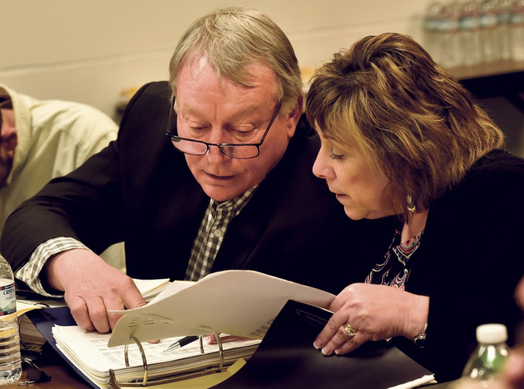 AOS 92 Superintendent Eric Haley, left, confers over budget figures with finance director Paula Pooler during a meeting Monday with the Winslow Town Council.