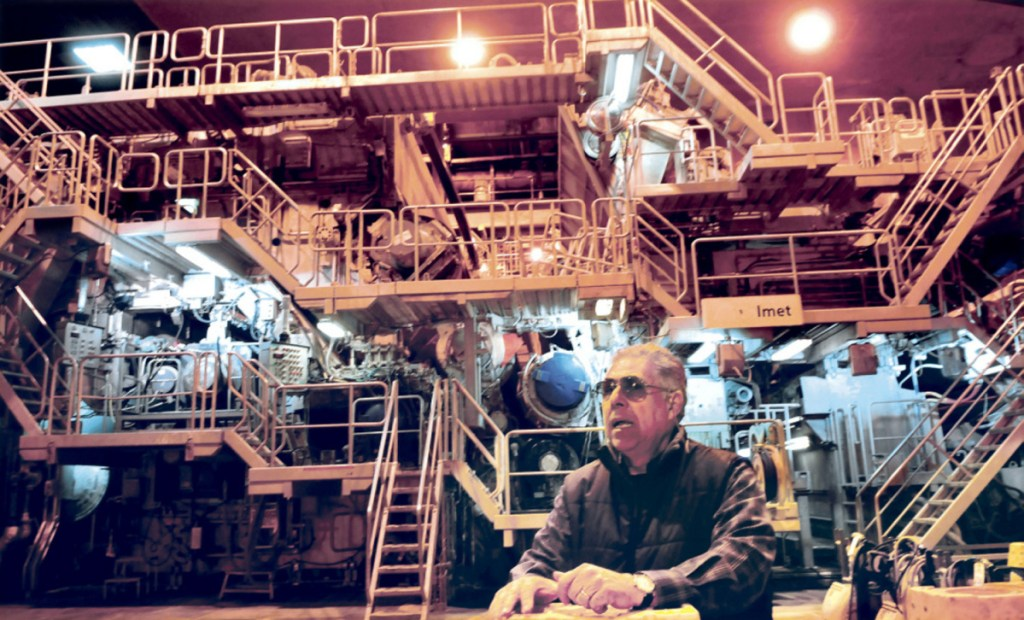 Jaime Broce, of Somerset Acquisition LLC and manager of the former Madison Paper Industries mill, stands in front of the No. 3 paper making machine , which was being sold via private negotiation on April 20, 2017, while other mill assets were sold at auction.