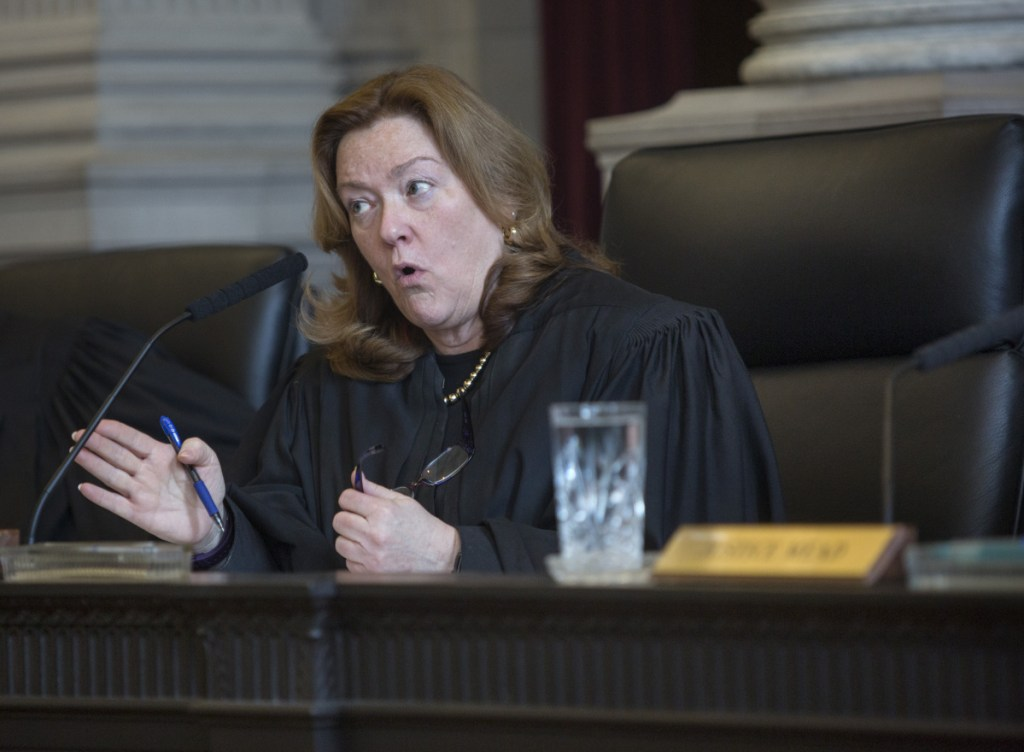 Chief Justice Leigh Saufley questions the state Senate's attorney, Tim Woodcock. She asked why the Legislature had not fixed issues with the Ranked Choice Voting Act.