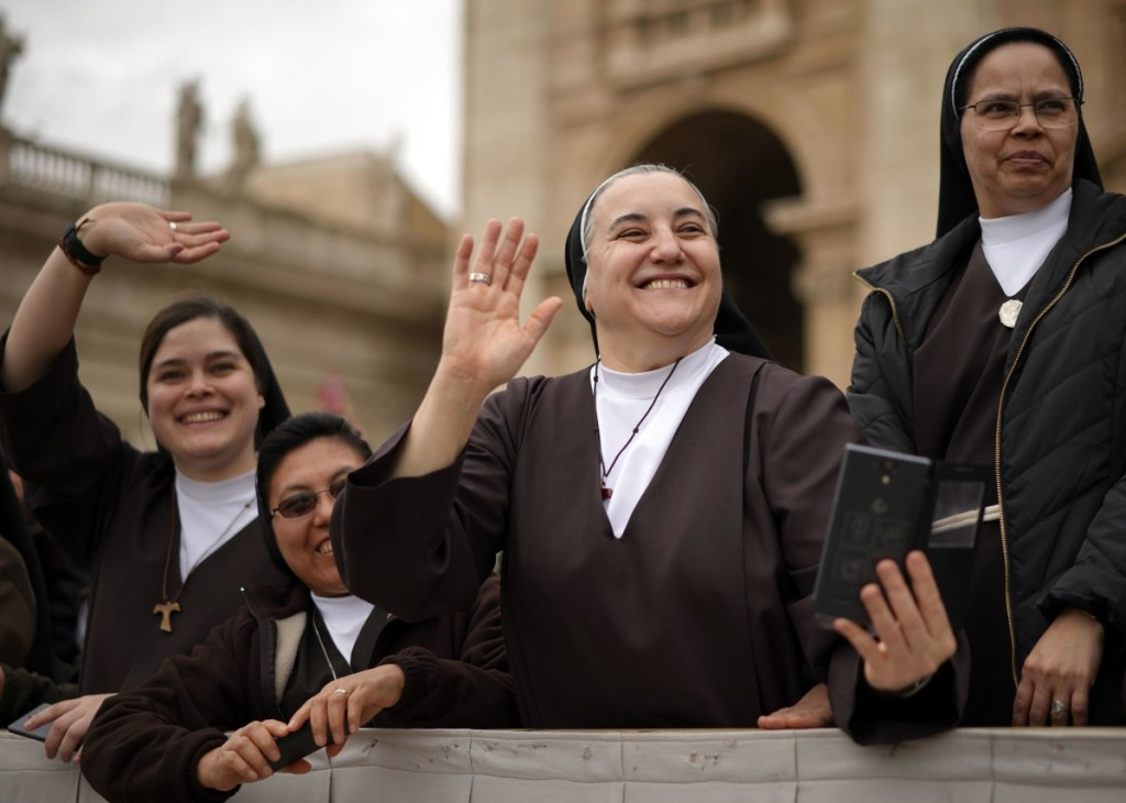 Nuns greet Pope Francis in St. Peter's Square. The issue of women's roles in the church is a recurring theme.