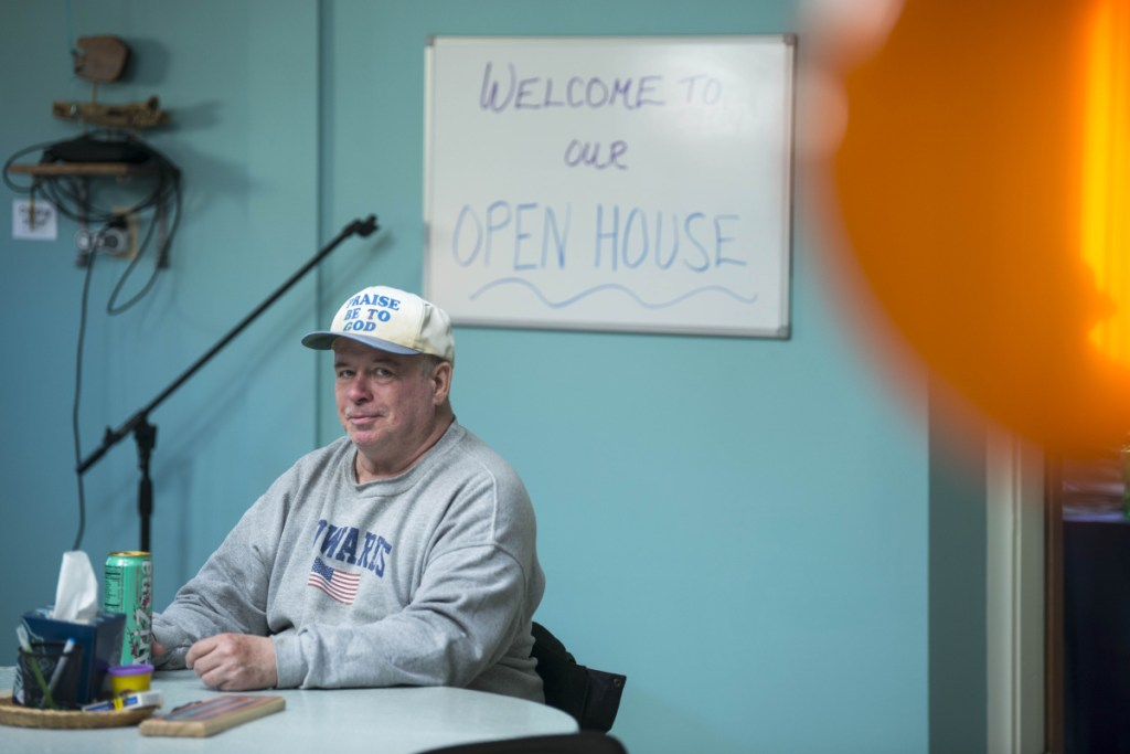 Howard Edwards enjoys snacks Thursday at an open house for the new National Alliance on Mental Illness peer recovery center in Waterville. The center offers support groups and classes to help those confronted by mental health or substance abuse challenges.