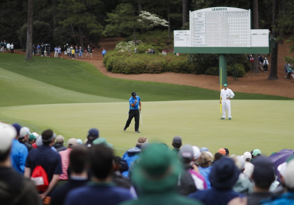 Patrick Reed celebrates his birdie on the 10th hole during the third round at the Masters on Saturday in Augusta, Georgia.