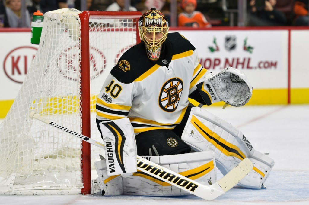 In this December 2017 photo, Boston Bruins goalie Tuukka Rask looks for a loose puck during the second period of a game against the Philadelphia Flyers, in Philadelphia. Rask and Toronto Maple Leage counterpart Frederik Andersen have near identical save percentages at .918 and .917, respectively.