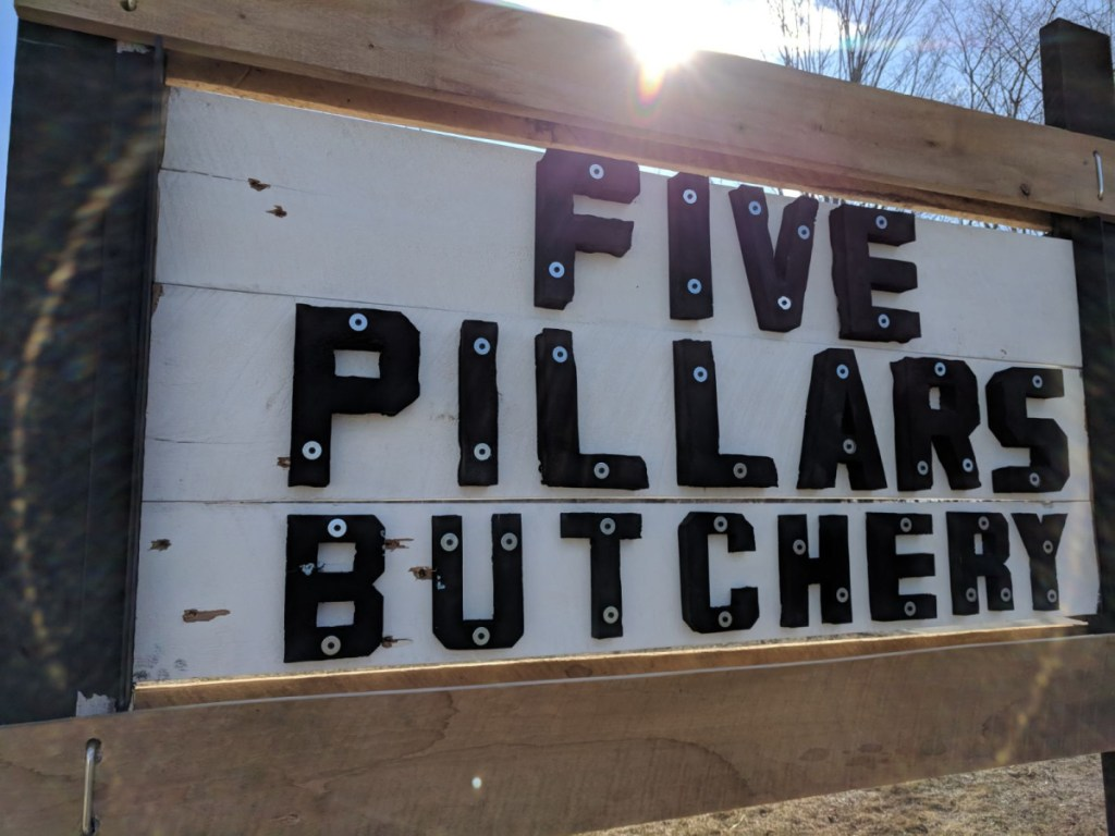 The sign advertising Hussam Al Rawi's butchery in Troy had eight holes shot into it Sunday, shortly after he put it up.