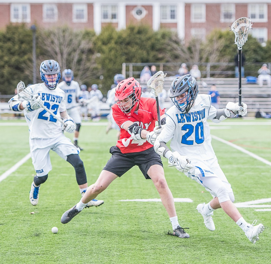 Cony's Ian Bowers and Lewiston's Tyler Marcoux double back for a loose ball during Wednesday's lacrosse game at Garcelon Field at Bates College in Lewiston.