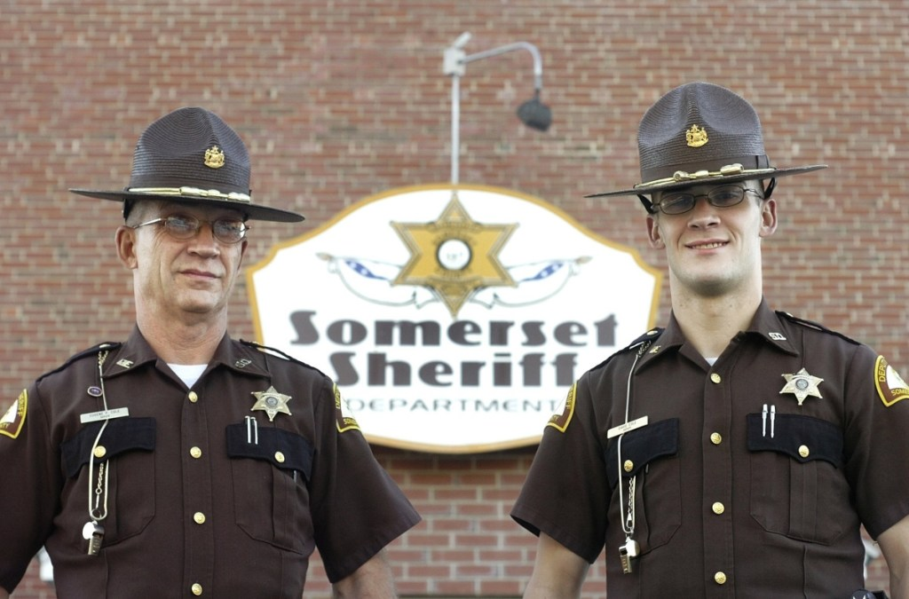 Eugene Cole, left, and his son David Cole, seen as Somerset County sheriff's deputies in 2007, entered law enforcement one after the other, with David Cole taking a job at the Kennebec County jail and his father joining the Somerset County Sheriff's Office in 2004. They graduated from the Maine State Police Academy a year apart, with Eugene Cole graduating in 2006 and his son in 2007.
