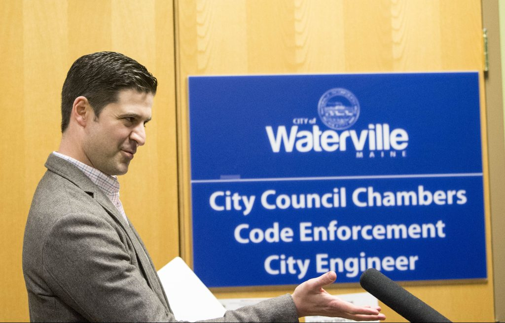 """Waterville Mayor Nick Isgro evades reporters' questions about his recent social media controversy Tuesday night before a city budget meeting, calling the reporters """"fake news."""""""