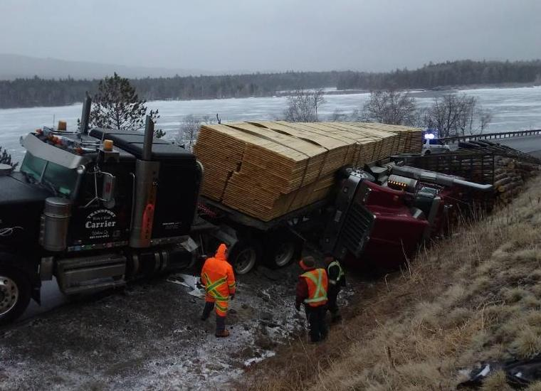 Two tractor-trailers were damaged Monday morning when they slid off the road at Natanis Point in Chain of Ponds Township. (Franklin County Sheriff's Office photo)