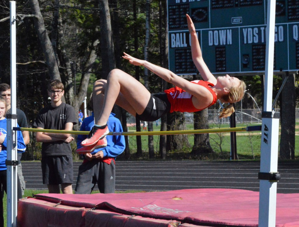 Cony's Tess Towle clears the bar in the high jump during a KVAC meet Monday.