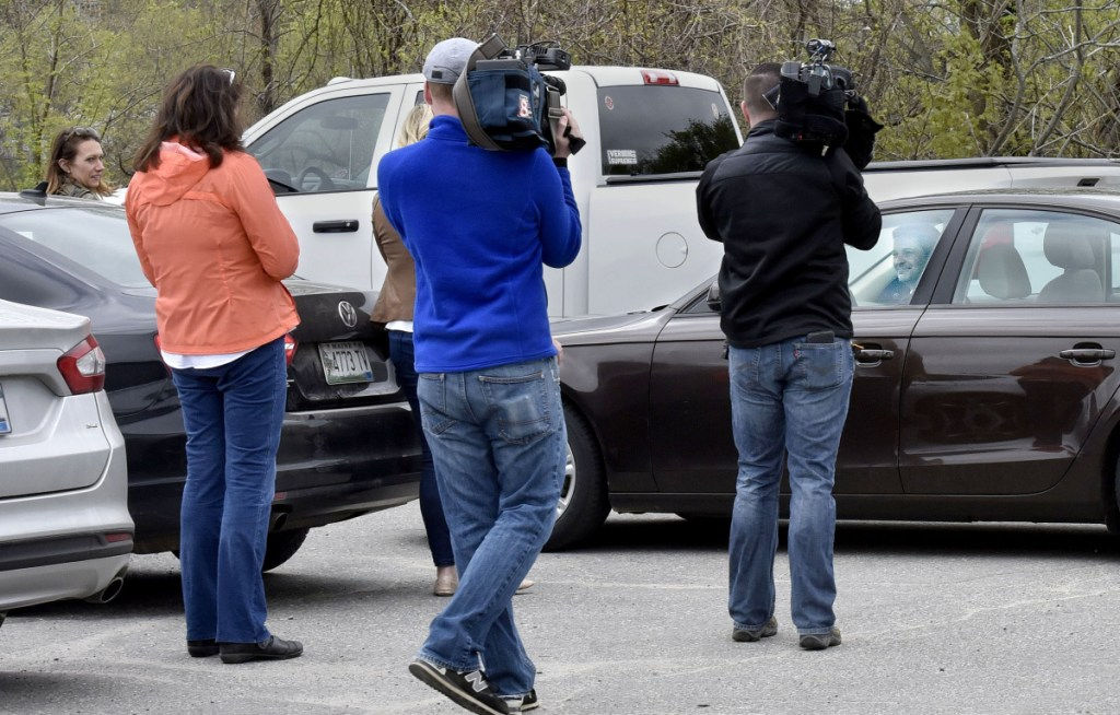 Waterville Mayor Nick Isgro backs his car away from reporters and would not answer questions following a press conference in Waterville on Monday.