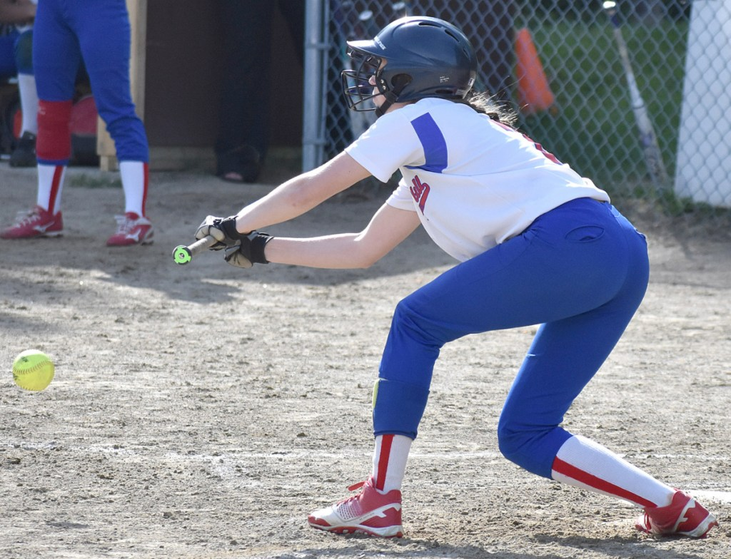 Oak Hill's Emily Ahlberg drops down a sacrifice bunt that scored a run in a win over Hall-Dale in Wales on Wednesday.