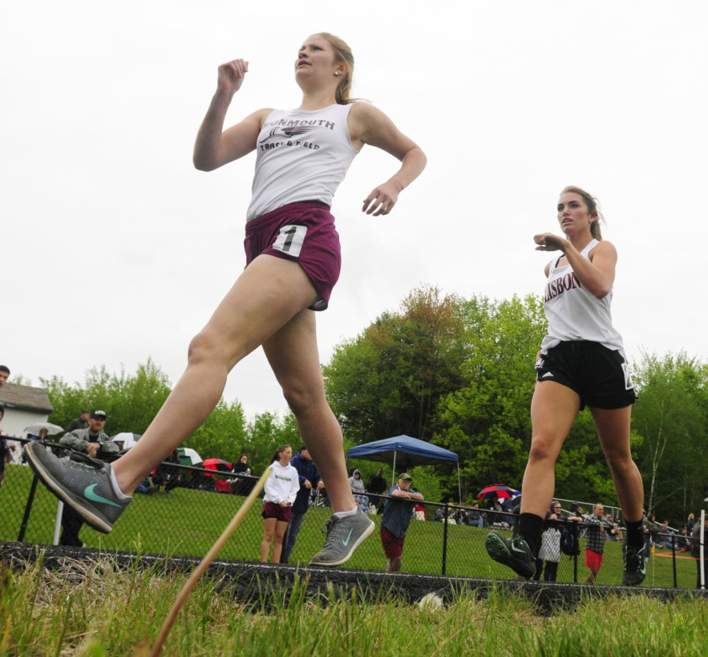 Monmouth Academy's Tori Spencer, left, has early lead in 1600 meter race walk at the Mountain Valley track championship last year at Lisbon High School.
