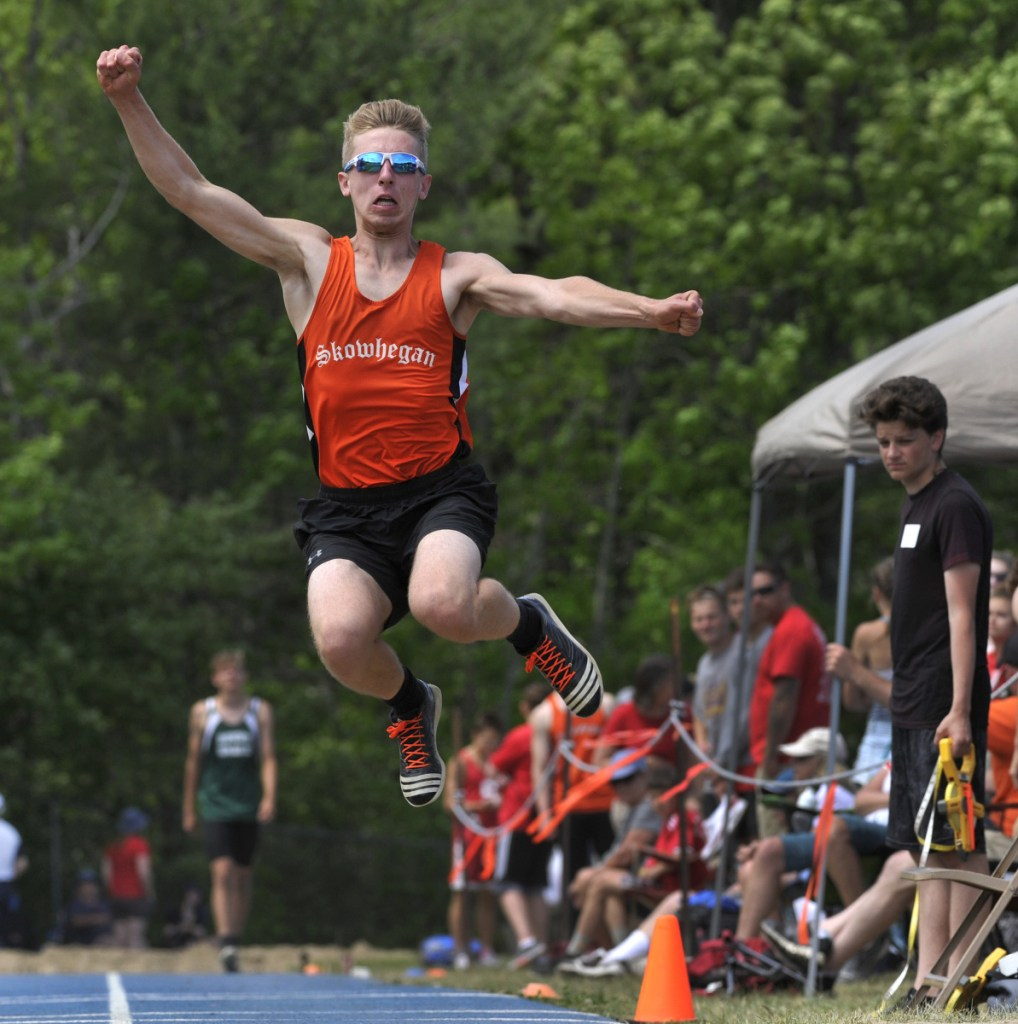 Skowhegan's Kyle Jacques jumps in the long jump competition at the Class A track and field state championships Saturday in Bath.