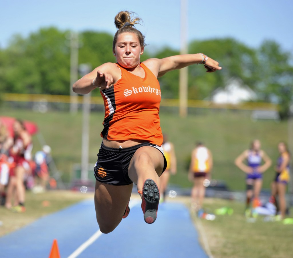 Skowhegan's Leah Savage competes in the girls triple jump event at the Class A track and field state championships Saturday in Bath.
