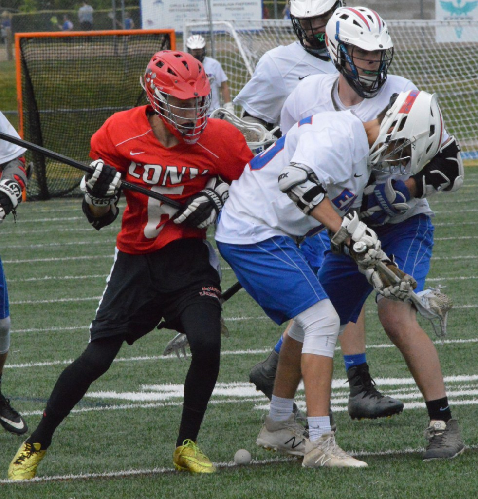 Sun Journal photo by Eric Maxim   Cony's Bradley Houston (6) battles with Mt. Ararat's Connor Brown (15) and Matt Lawrence (9) during a Class B prelim game Wednesday in Topsham.