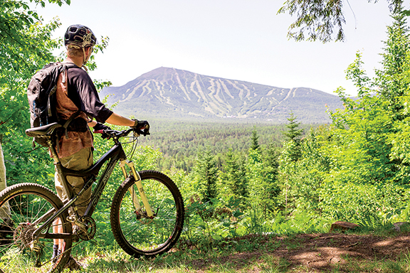 Western Maine offers spectacular views and outdoor challenges.  The Carrabassett Valley network of hiking and biking trails and the Sugarloaf Golf Club partner nicely with the many area festivals, road races and concerts planned for this summer.  Jamie Walter photo