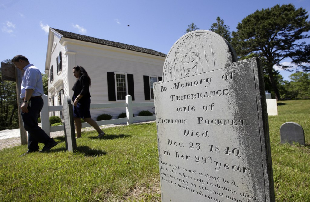 A grave stone stands on Mashpee Wampanoag land on Cape Cod. The tribe says an unfavorable decision from the U.S. Interior Department would effectively shut down certain government operations, including the tribe's new court system and police force.