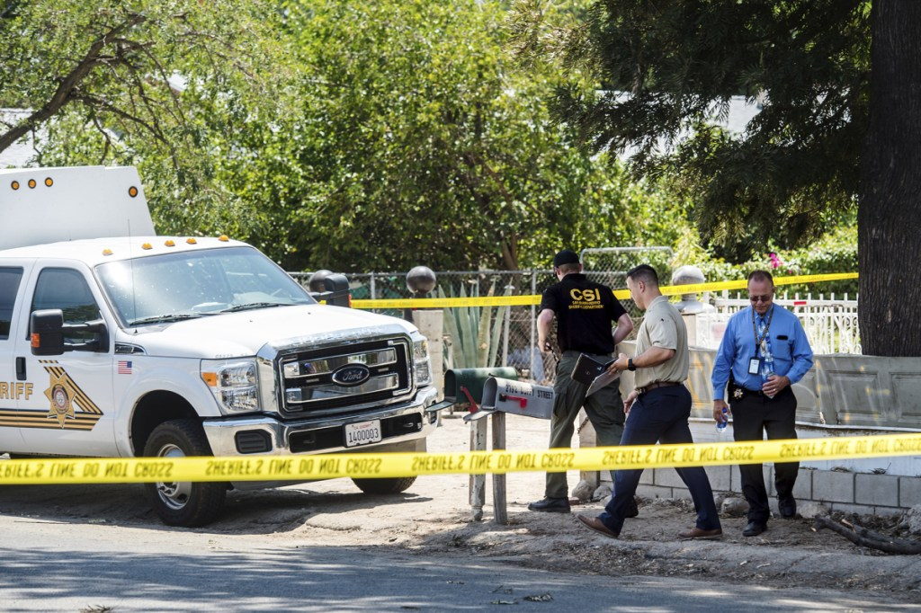 San Bernardino County Sheriff's personnel investigate the scene of a fatal shooting on Friday in Muscoy, Calif. Authorities say a 4-year-old boy accidentally shot and killed his 2-year-old cousin at a home in Southern California.