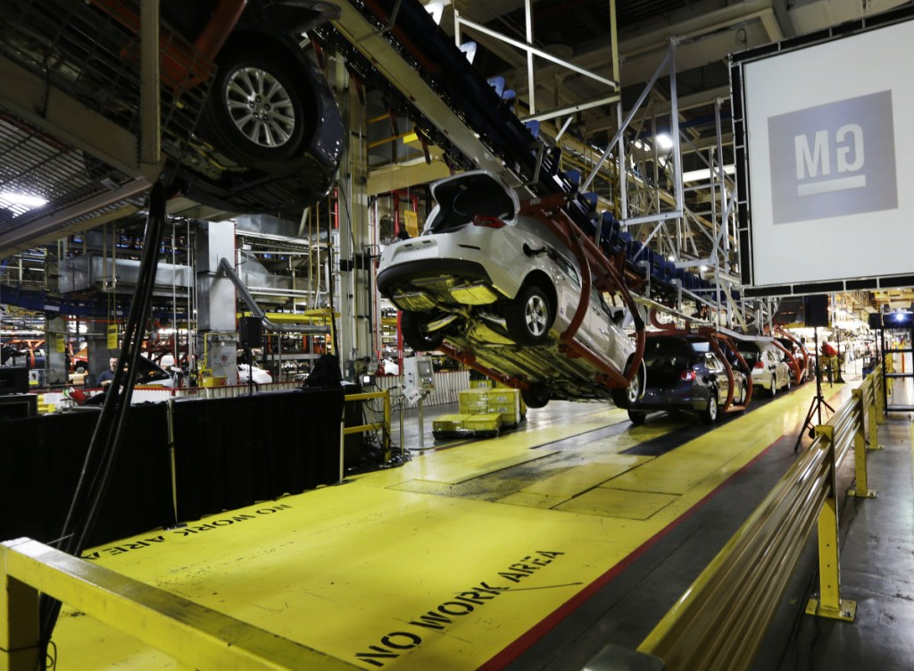 Cars move along an assembly line at a General Motors plant in Kansas City, Kan., in 2013. Analysts say that with too many factories making slow-selling cars, the automaker can't afford to keep them all operating without making some tough decisions.