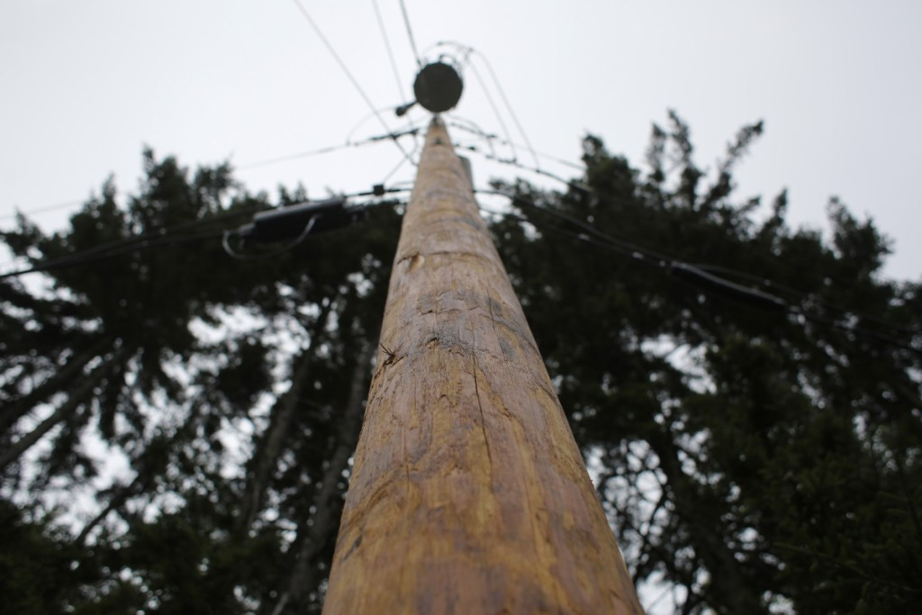 A new, stouter utility pole on Harpswell's Firehouse Road replaces one of the hundreds across Maine that were downed in an October 2017 wind and rain storm. Central Maine Power's parent company is preparing a multimillion plan to harden its power distribution system against storms.