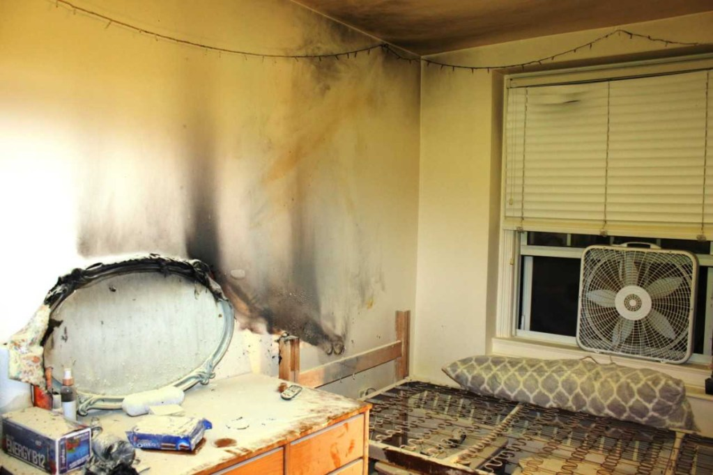 The walls and ceiling of a Colby College dormitory room appear black and damaged from a fire and smoke that broke out early Tuesday morning. A student living in the room told investigators that she fell asleep after lighting a candle.